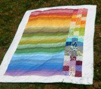 http://cutefluffinstitch.com/item/twin-rainbow-quilt-handmade-ombre-colorful