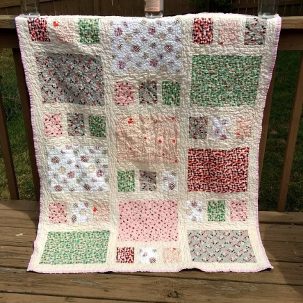 http://cutefluffinstitch.com/item/baby-quilt-oversized-crib-pink-grey-red-green-and-cream-handmade-quilts