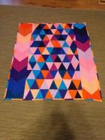 http://cutefluffinstitch.com/item/quilt-jewel-tone-geometric-triangles-illuminati-arrows